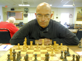 Sandor Kustar at the board searching for his next move.